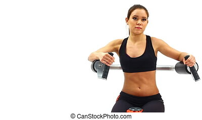 Brunette woman on hydraulic exerciser. White background