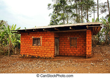 African house made of red earth bricks - Typical red earth...