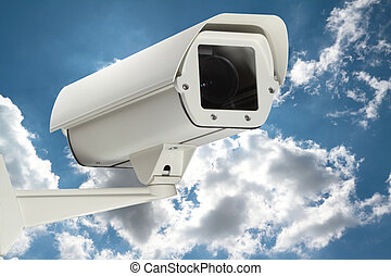 security - New security camera with cloudy sky as a...