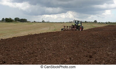 heavy tractor plow field - heavy agriculture machine tractor...