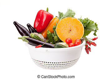 Colander With Vegetables On White - Colander with mix of...