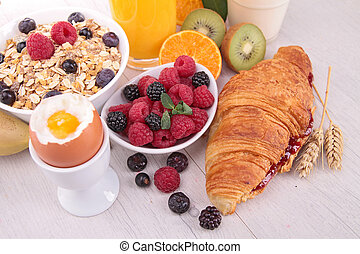 breakfast with egg,croissant,drinks and fruits