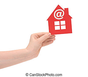 woman hand holding small red plastic house with email icon...