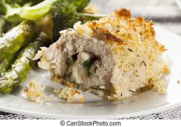 Breaded Homemade Chicken Cordon Bleu with fresh vegetables