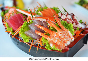 Sashimi seafood set in a boat blow - Japanese style food