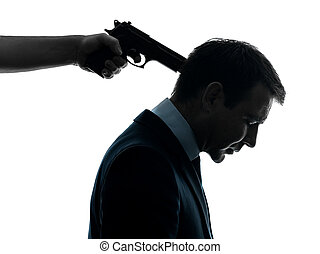 business man with gun pointing to his head silhouette - one...