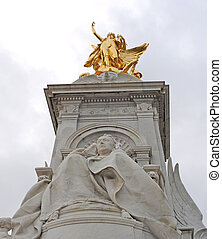 Detail of the Victoria Memorial in Queen's Gardens at Buckingham Palace, London, on a cloudy day