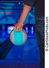 African hand holding a bowling ball - African American hand...