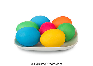 Colorful painted Easter eggs in beautiful chinaware