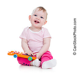 smiling girl baby playing with musical toy