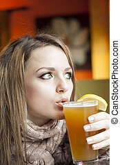 Young Woman with Beautiful Blue Eyes Drinking Beer -...