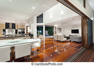 Modern home - Luxurious home interior with large sliding...