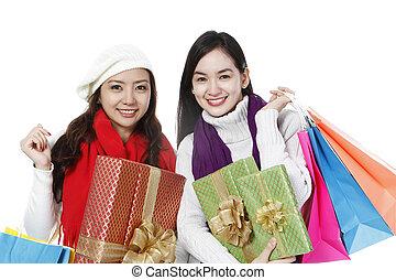 Young Women Shopping - Two young women in winter clothing...