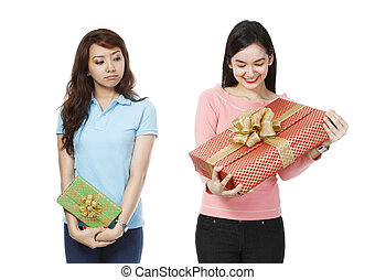 Envious of Bigger Gift - A young woman envious of the much...