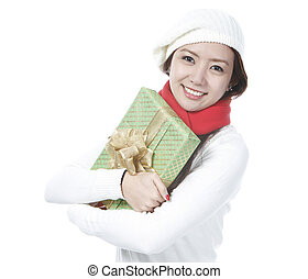 Young Lady Loving Her Present - A young woman hugging her...