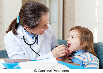 Doctor looks mouth of child - Doctor looks mouth of 2 years...
