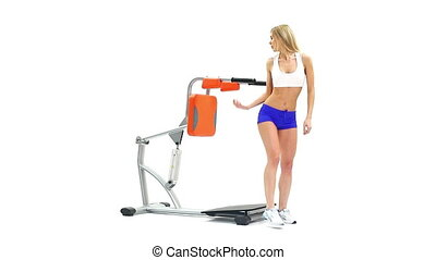 Blonde woman on hydraulic exerciser White background