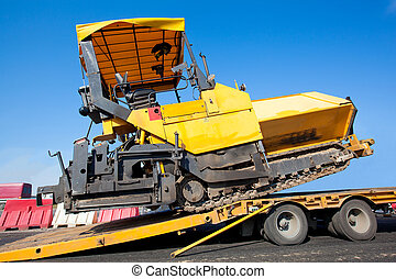 Transportation tracked paver machine during roadworks for...