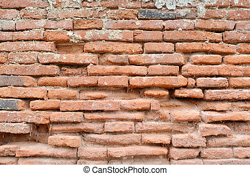 Weathered stained old brick wall background