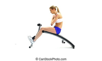 Slim young woman on exerciser