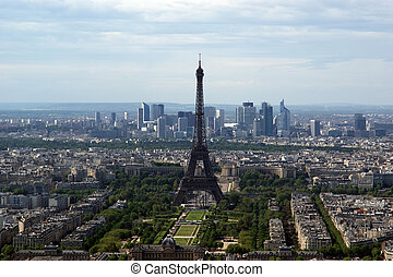 The city skyline at daytime. Paris, France. Taken from the tour Montparnasse with the Eiffel Tower, Le Grande Palais, Les Halles, St. Eustace & La Defense clearly visible