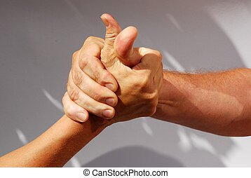 two competing hands - two middle aged hands competing or...