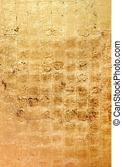 Golden bronze colored grunge texture or background - An...