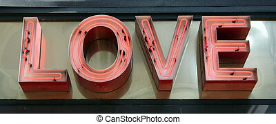 Love Sign - A pink neon sign that reads Love