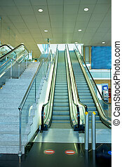 metal and glass escalator and stairs