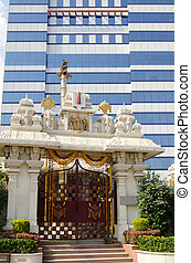 Ancient Religion, Modern Business - A Hindu Temple beside a...
