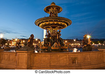Fountain at the Place de la Concorde in Paris by night,...