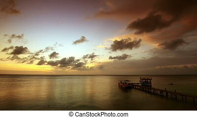Beautiful sunset on the Caribbean coast of the island of...