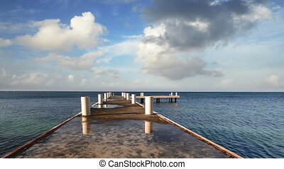 Morning pier stretching into the horizon of the Caribbean...