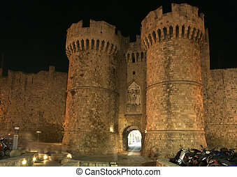 Medieval city walls in Rhodes town night, Greece