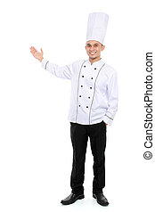 male chef smiling presenting blank space - Portrait of...
