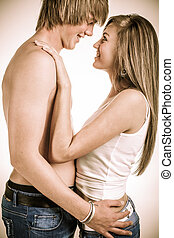 Eye contact - A young high school boy and his girlfriend...