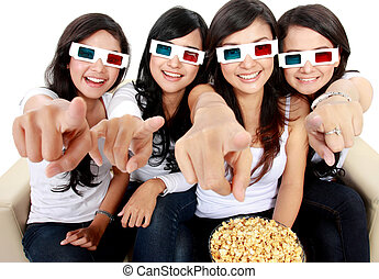 woman pointing to TV while watching 3d movie - girl friends...