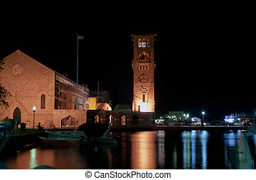 Rhodes island landmark, Mandraki Port, Greece. The historical port is still used today as a marina by small yachts and ferries