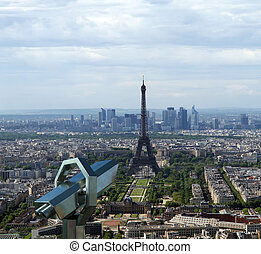 Telescope viewer and city skyline at daytime. Paris, France....