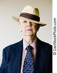 Dramatic Senior Woman Wearing a Hat - Dramatic senior woman...