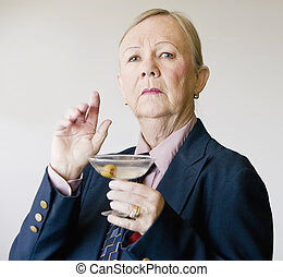 Dramatic Senior Woman with a Martini - Dramatic senior woman...