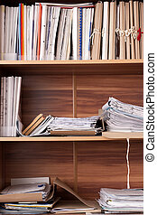 Archival documents folders on the three shelves