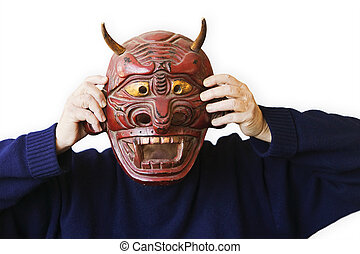 Person Holding Up A Devil Mask - person wearing a blue...