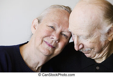 Senior Couple - Close-up of senior couple embracing focuses...