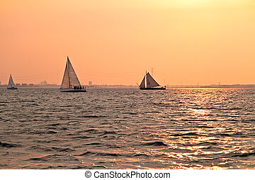 sailing at sunset on the IJsselmeer in Netherlands - Sailing...