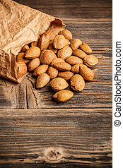Almond nuts on very old wooden table
