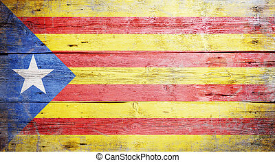 Flag of Catalonia painted on grungy wooden background
