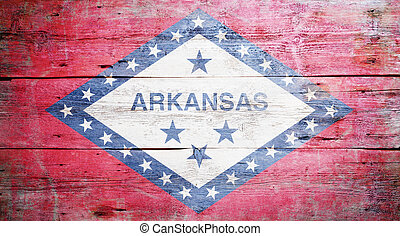 Flag of Arkansas painted on grungy wooden background