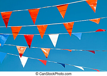 orange flags, celebrating queens day in the Netherlands -...