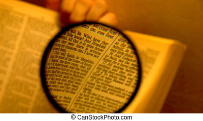 magnifier - book through a magnifying glass